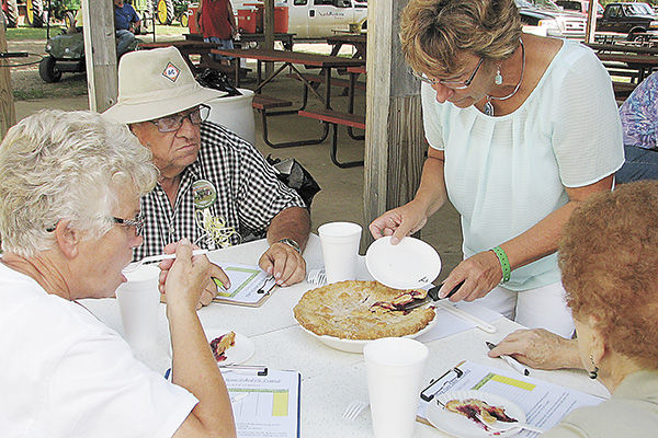 The judges for this summer's South Dakota Home Baked Pie Contest were Myron Downs of Madison, Aggie Kroeger (left) of Lennox, and Delores Arbeiter (right) of Marion.