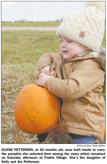 Photo of Eloise Pettersen carrying pumpkin
